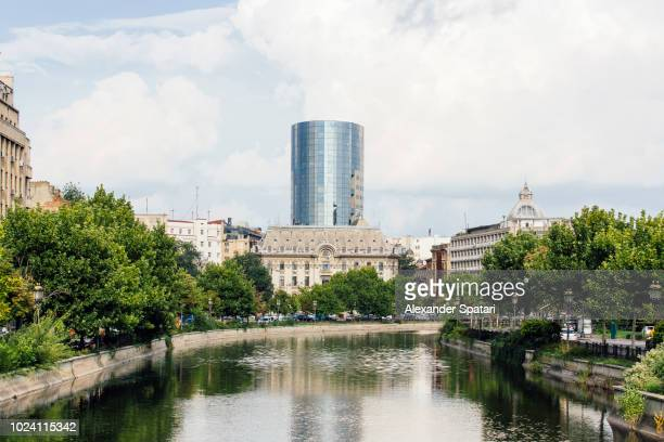 bucharest skyline with river dambovita, old historic house and new modern skyscrapers, bucharest, romania - bucharest stock pictures, royalty-free photos & images