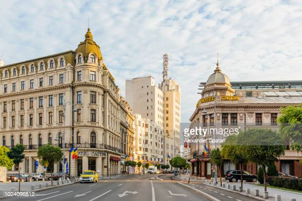 bucharest street with historic buildings early in the morning, bucharest, romania - rumania fotografías e imágenes de stock