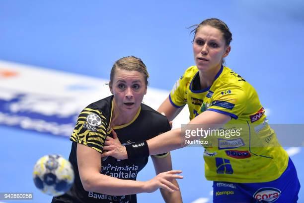 Bucharest's Isabelle Gullden vies Metz Handball's Xenia Smits during 2017/18 EHF Women's Champions League Quarter Final match between CSM Bucharest...