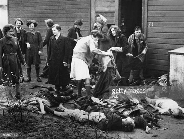 Buchenwald concentration camp during 2nd world war women salvaging clothes on corpses