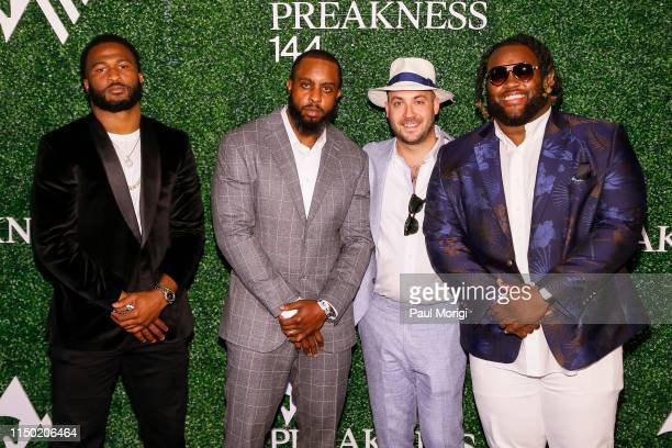 Buck Allen Albert McClellan Judah Estreicher and Michael Pierce at the 144th Preakness Stakes at Pimlico Race Track on May 18 2019 in Baltimore...