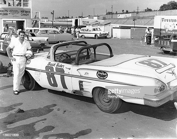 Buck Baker with the 1958 Chevrolet he drove on the NASCAR Convertible Series circuit Baker ran in eight Convertible events during the season and took...