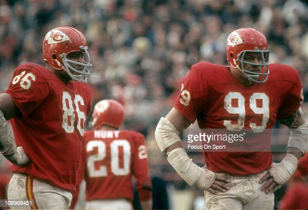 Buck Buchanan and Ernie Ladd of the Kansas City Chiefs looks on waiting for the New York Jets offense to come to the line of scrimmage during an NFL...