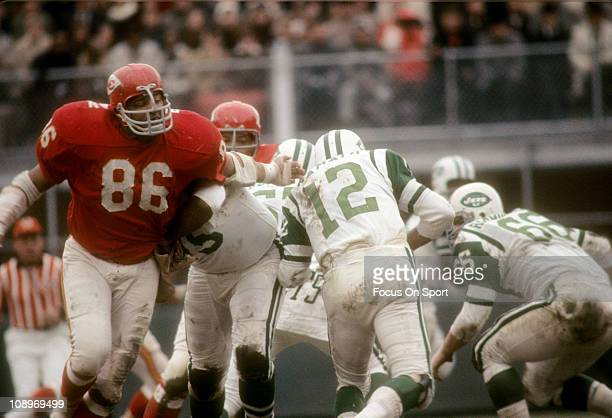 Buck Buchanan of the Kansas City Chiefs pursues quarterback Joe Namath of the New York Jets during an NFL football game at Kansas City Municipal...