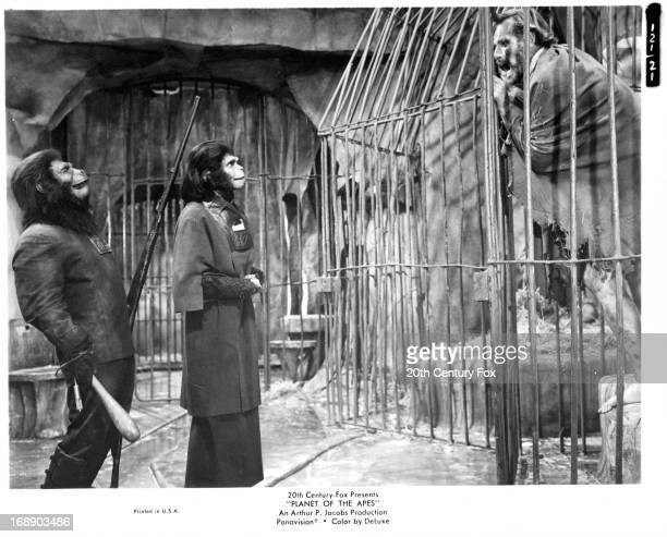 Buck Kartalian laughs as Kim Hunter is defied by Charlton Heston in a scene from the film 'Planet Of The Apes' 1968