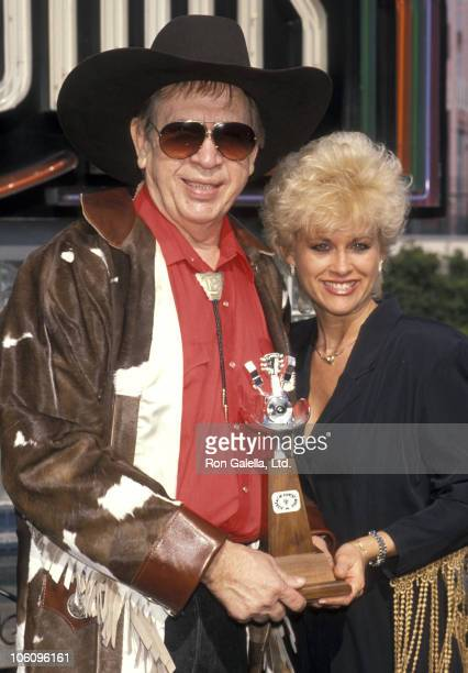 Buck Owens and Lori Morgan during ACM Nominations - February 27, 1990 at Universal Studios in Universal City, California, United States.