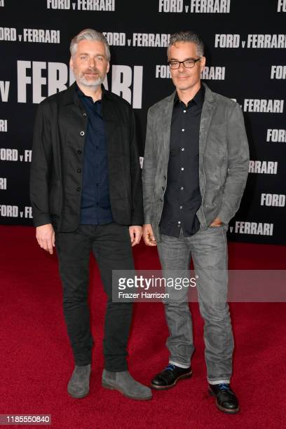 Buck Sanders and Marco Beltrami attend the Premiere of FOX's Ford V Ferrari at TCL Chinese Theatre on November 04 2019 in Hollywood California