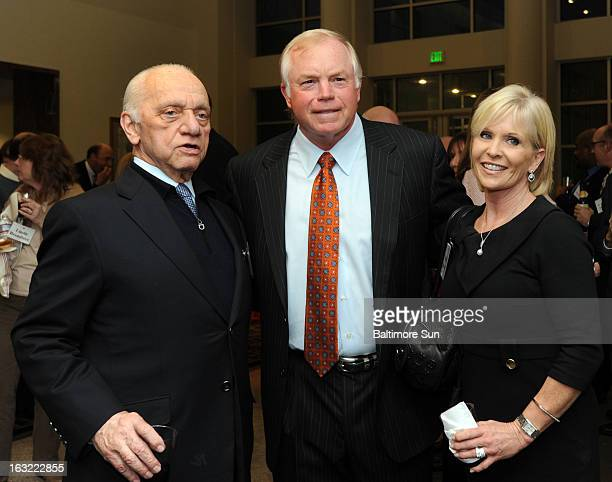 Buck Showalter, Baltimore Orioles manager, center, attends a reception before receiving his Marylander of the Year award from the Baltimore Sun,...