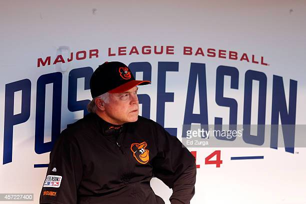 Buck Showalter of the Baltimore Orioles looks on from the dugout prior to Game Three of the American League Championship Series against the Kansas...