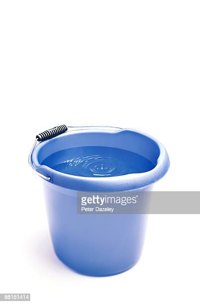 bucket catching dripping water from a leak. - bucket stock pictures, royalty-free photos & images
