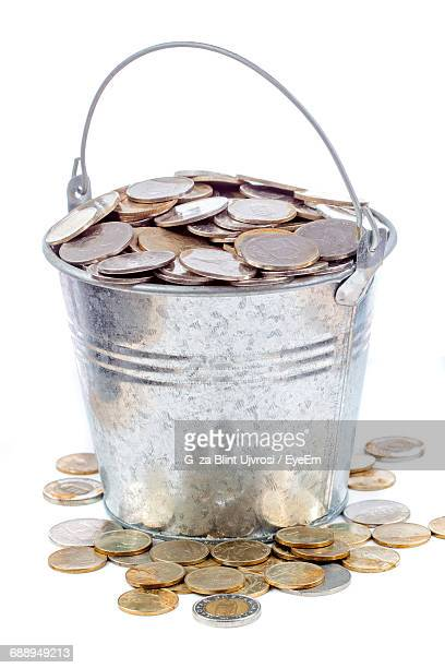 Bucket Filled With Money Against White Background