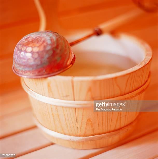 A bucket in a sauna.