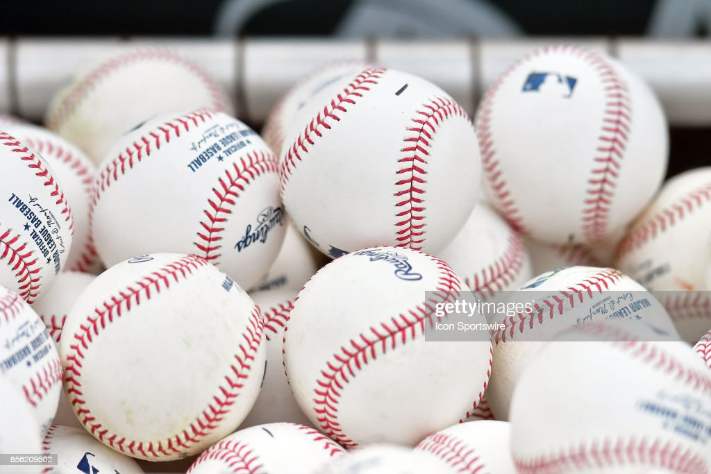 A bucket of baseballs as seen during batting practice before