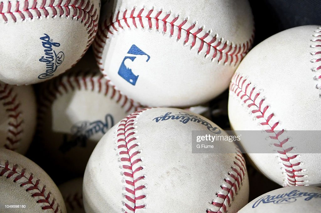 A bucket of baseballs in the dugout during the game between