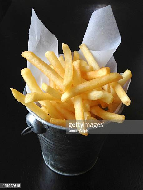 bucket of chips - fast food french fries stock photos and pictures