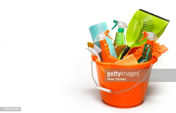 bucket of cleaning products ready to spring clean, with copy space - dustpan and brush stock pictures, royalty-free photos & images