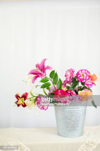 bucket of fresh roses and lilies from my garden - mazzo di rose foto e immagini stock