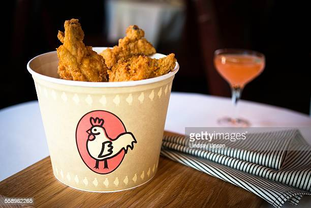 bucket of fried chicken on restaurant table - bucket stock pictures, royalty-free photos & images
