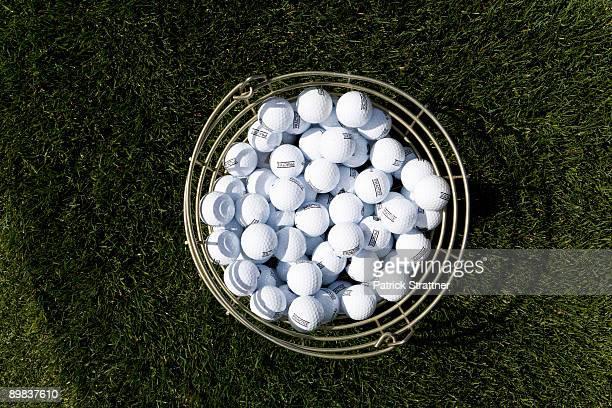 A bucket of golf balls
