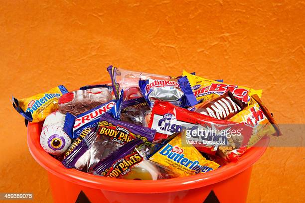 bucket of halloween candies - halloween candy stock photos and pictures