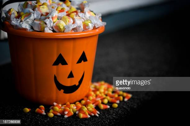 Bucket of Halloween Candy with Jack o Lantern, Copy Space
