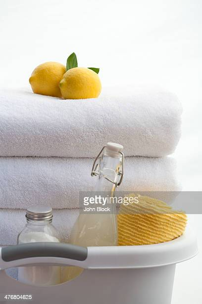 Bucket of soap, towels and lemons