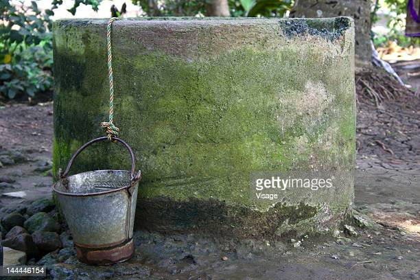 A bucket placed next to a well
