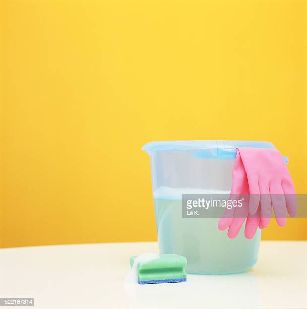 Bucket, rubber gloves and sponge