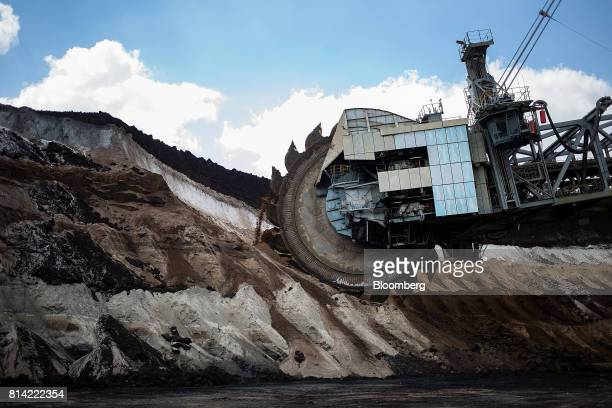 A bucket wheel excavates soil and lignite during mining operations at the Garzweiler open cast mine operated by RWE AG in Garzweiler Germany on...