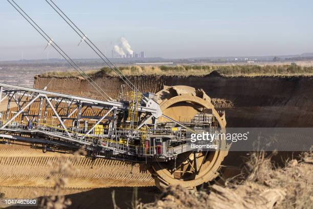 A bucket wheel excavates soil and rocks as a giant excavator operates at the open pit lignite mine operated by RWE AG in Hambach Germany on Friday...