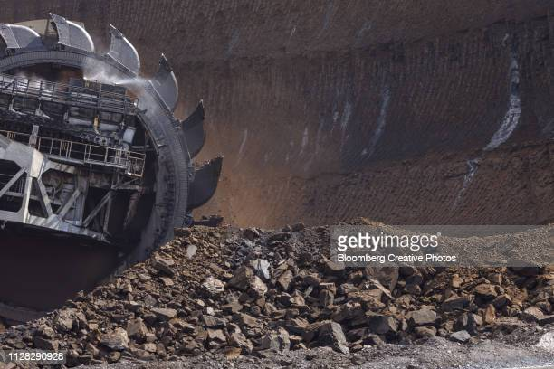 a bucket wheel excavates soil and rocks - coal mine stock pictures, royalty-free photos & images
