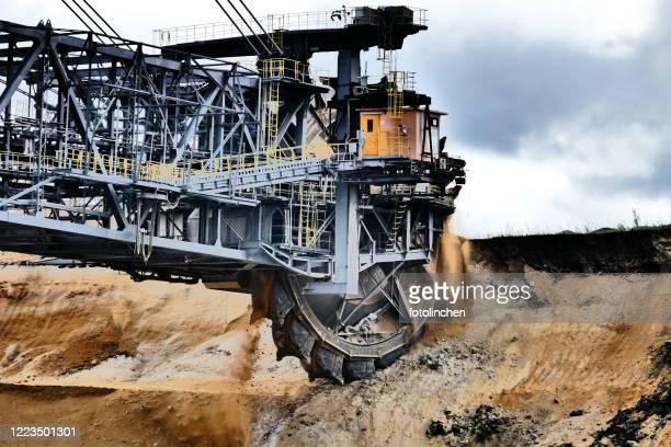 bucket wheel excavator in a lignite mine - crane construction machinery stock pictures, royalty-free photos & images