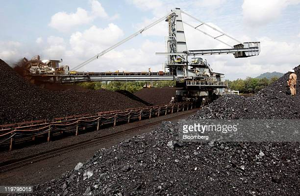 A bucket wheel excavator moves coal onto a conveyor belt at the PT Bukit Asam open pit coal mine in Tanjung Enim South Sumatera province Indonesia on...