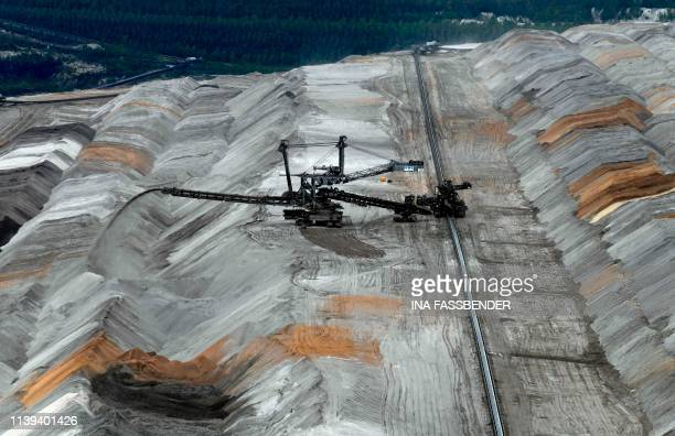 A bucket wheel excavator operates to dig brown coal at the Hambach lignite opencast mine of German energy giant RWE near Kerpen western Germany on...