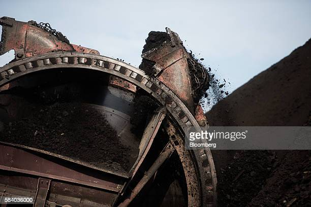 A bucket wheel excavator transports brown coal at the Visonta open cast lignite mine operated by Matrai Eromu Zrt in Visonta Hungary on Wednesday...