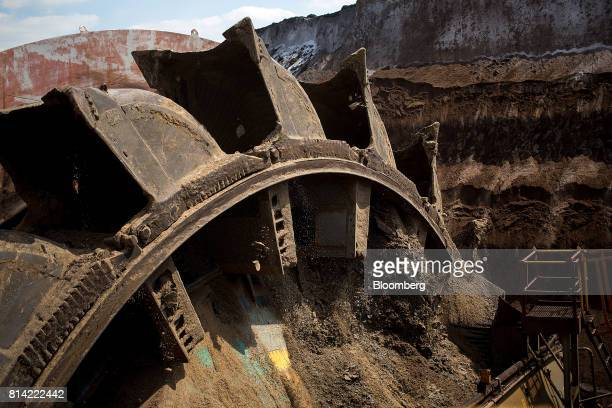 A bucket wheel rotates during mining operations at the Garzweiler open cast lignite mine operated by RWE AG in Garzweiler Germany on Thursday July 13...