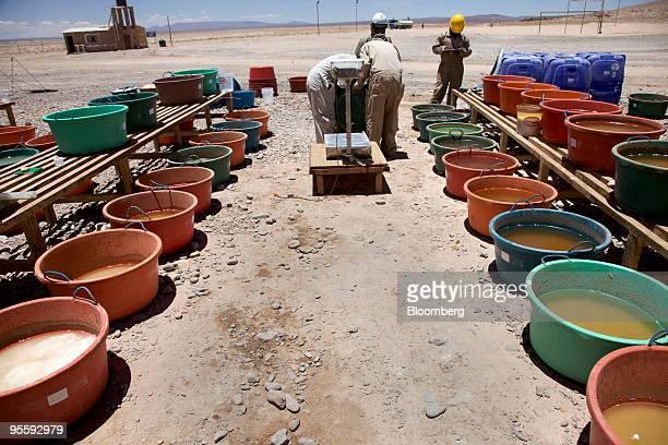 Buckets of salt brine sit during the evaporation process to isloate lithium at the Uyuni Salt Flat in Uyuni Bolivia on Nov 21 2009 The salt flat is...
