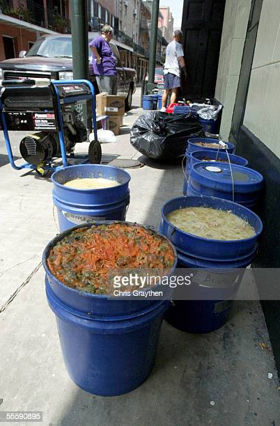 Buckets of spoiled food removed during cleanup stand outside Tujaques restaurant in the French Quarter September 15 2005 in New Orleans Louisiana...