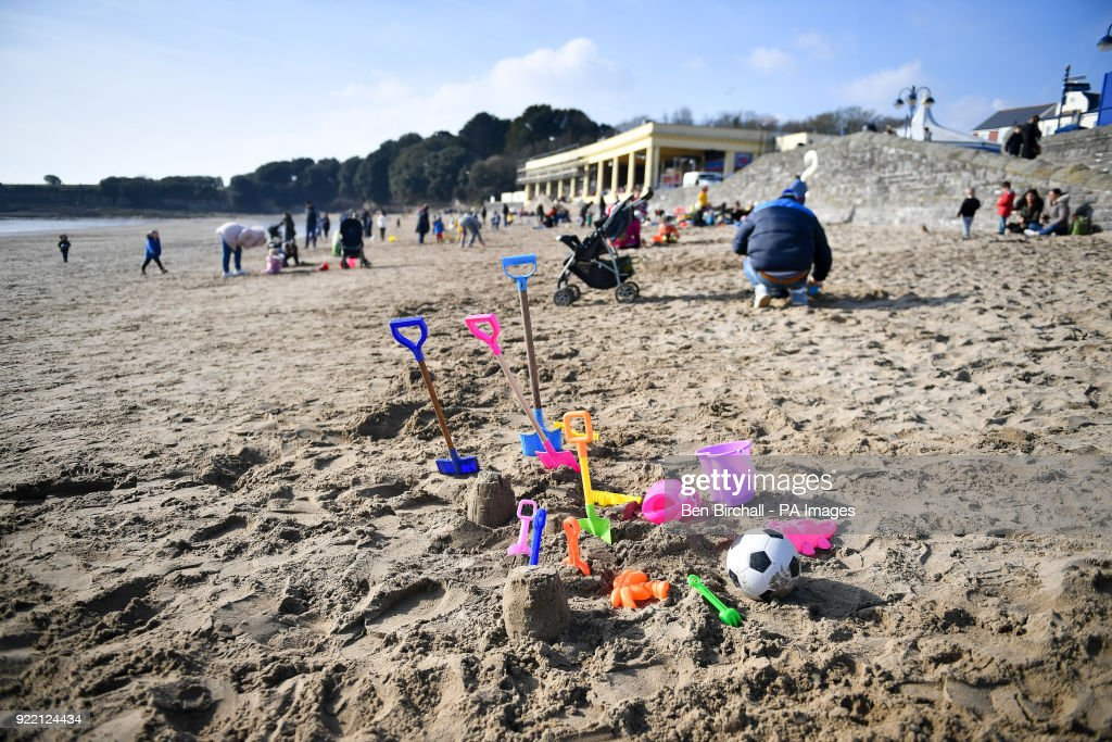 Buckets, spades and toys on the beach during sunny weather at Barry Island in South Wales as temperatures reach single figures.