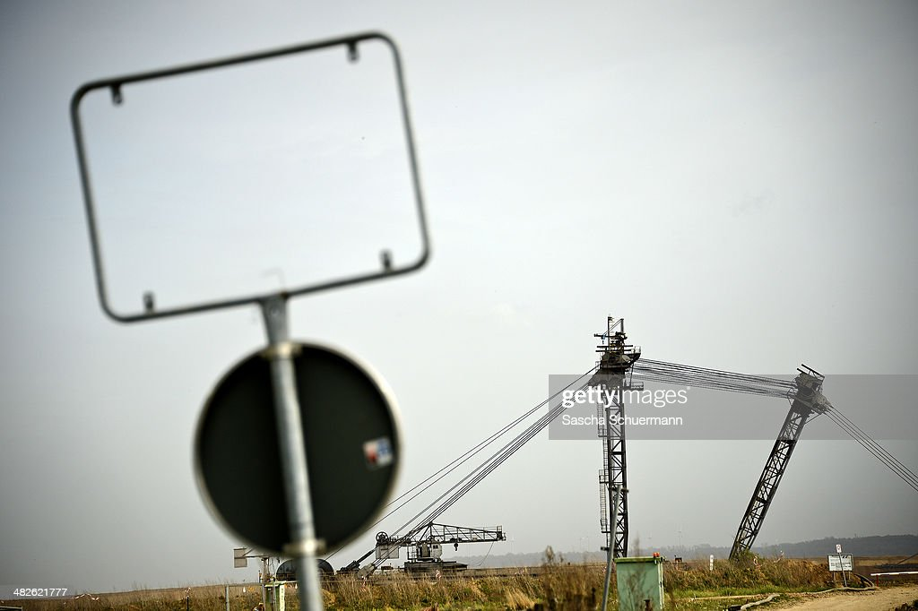 A bucket-wheel excavator extracts coal from the brown coal open cast mine Garzweiler on April 3, 2014 in Immerath, near Grevenbroich, Germany. The small town of Immerath and surrounding towns belonging to Erkelenz will be wiped off the map to allow energy giant RWE enlarge the huge open pit mine Garzweiler. A recent European Union study rated the Neurath power plant as the biggest emitter of CO2 in Germany, with 33.3 million tons in 2013, making it the second biggest in Europe. Owned by energy conglomerate RWE, the Neurath plant began operation in the 1970s and expanded with added blocks in 2012. It currently produces 4,400 megawatts of electricity annually, making it also the second biggest electricity producer in Europe.
