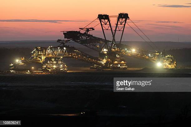 A bucketwheel excavator removes the first layer of soil for the expansion of the nearby Welzow openpit lignite coal mine on August 20 2010 near...