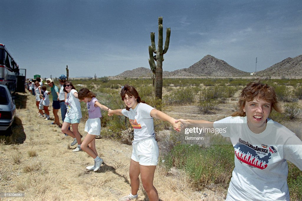 People Forming Human Chain in Hands Across America : News Photo