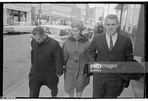 Bucking an extremely strong wind Teamster leader Jimmy Hoffa his wife and son James P Hoffa leave the Federal Courthouse following a lunch recess...