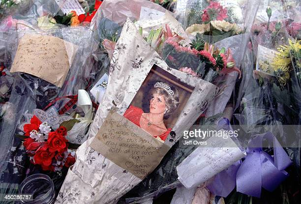 Buckingham Palace flowers laid for Diana Princess of Wales Close up of floral bouquet with photo of Diana left as a tribute outside Buckingham Palace...