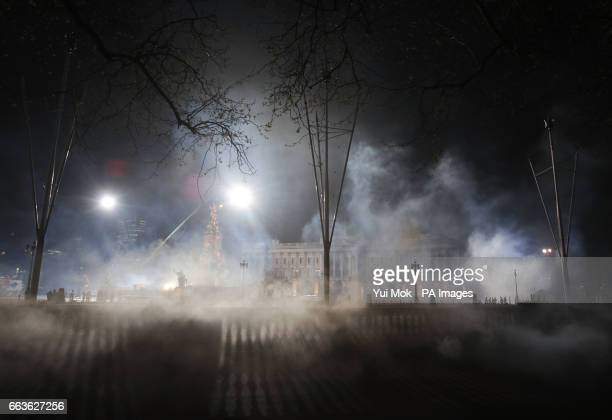 Buckingham Palace in London is shrouded in 'smog' produced by smoke machines during filming of the movie sequel Mary Poppins Returns