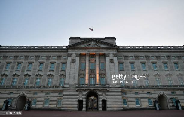 Buckingham Palace, the official residence of Britain's Queen Elizabeth II, is pictured in London at dusk on March 9, 2021. - Queen Elizabeth II is...