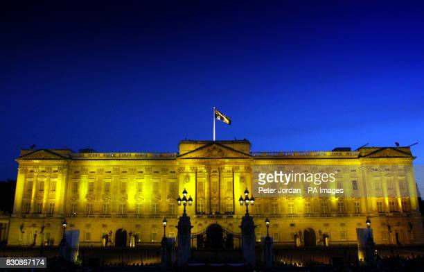 Buckingham Palalce the official London residence of Queen Elizabeth II is lit by goldcoloured floodlights as 12000 partygoers attended a Prom at the...