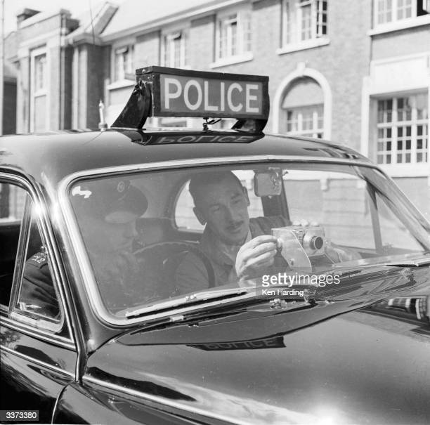 Buckinghamshire police car being fitted for the first time with a camera to record careless or reckless driving and to provide evidence in court if...