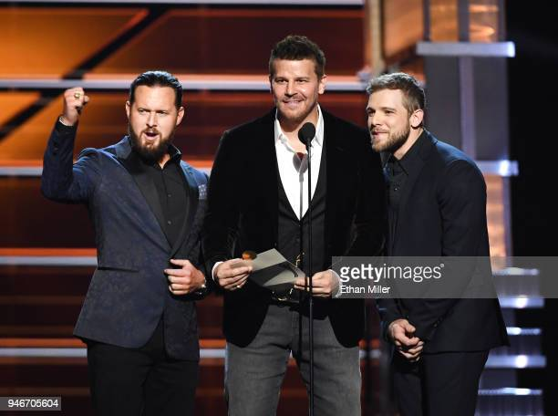 AJ Buckley David Boreanaz and Max Thieriot present an award onstage during the 53rd Academy of Country Music Awards at MGM Grand Garden Arena on...