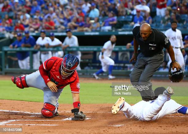 Bucknor umpire looks on as Shohei Ohtani of the Los Angeles Angels of Anaheim hits in the third inning against the Texas Rangers at Globe Life Park...
